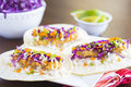 Ahi katsu sushi tacos fried breaded tuna rice purple cabbage green onions masago capelin fish roe and wasabi mayonnaise on corn Royalty Free Stock Image