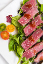 Ahi tuna salad bright red yellow fin sashimi on white background Stock Photography