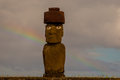 Ahu ko te riku single moai at tahai ceremonial site on rapa nui with rainbow in background Royalty Free Stock Photography