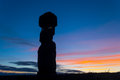 Ahu tahai silhouette of moai against a colorful sky at sunset at easter island rapa nui chile Stock Images