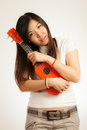 Aian woman enjoy her ukulele asian give a hug to new Stock Photography