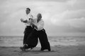 Aikido technique masters demonstrating self defense martial arts concept Stock Images