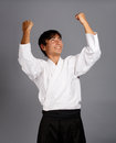 Aikido winner happy man in uniform Stock Photo