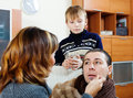 Ailing man surrounded by caring wife and son men loving at home Royalty Free Stock Images