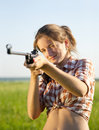 Aiming girl Royalty Free Stock Photo
