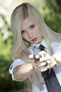 Aiming with gun woman in shirt and tie a handgun in the camera Royalty Free Stock Photography