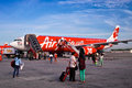Air asia plane passengers walking to Royalty Free Stock Photos