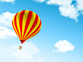 Air balloon in clouds the blue sky with Royalty Free Stock Photo