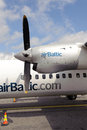 Air Baltic propeller airplane in Riga airport Royalty Free Stock Photo