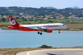 Air berlin airbus a landing an is with motion blur at corfu airport lagoon in background Stock Images