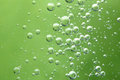 Air bubbles in liquid abstract green background macro a Royalty Free Stock Photography