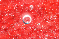 Air bubbles in  liquid. Abstract red background. Macro Royalty Free Stock Photo