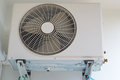 Air conditioner fan white on the wall Stock Photo