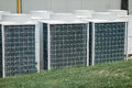 Air conditioner unit condenser outside a house Stock Photo