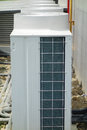 Air conditioner unit condenser outside a house Stock Photos
