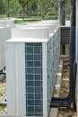Air conditioner unit condenser outside a house Royalty Free Stock Photography