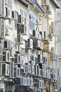 Air conditioners in busy asian city street Stock Image