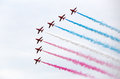 Air force stunt team red arrows flying in formation with coloreed smoke trails Stock Photography