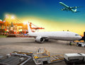 Air freight and cargo plane loading trading goods in airport con Royalty Free Stock Photo