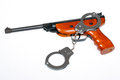Air gun with handcuffs Stock Photography
