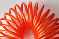 Air hose orange red spiral plastic used for pneumatic tools Stock Photos