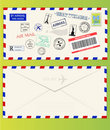 Air mail envelope with postal stamps Royalty Free Stock Photo