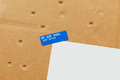 Air mail par avion envelope parcel damaged detail delivered with damages seven small perforations on the cardboard Royalty Free Stock Photos