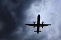 Air plane evading storm silhouetted prop against a foreboding cloudy sky Stock Photography