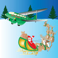 Air santa claus in his reindeer drawn sleigh travelling towards his vintage private plane with a snow background suitable for Royalty Free Stock Photo