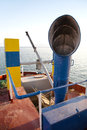 Air shaft on an old ship in blue color. Retro or vintage style. Royalty Free Stock Photo