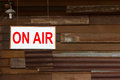 On air sign with old wooden wall background Royalty Free Stock Images