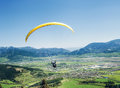 Air sportsman fly on paraplane over the mountain valley Royalty Free Stock Photo