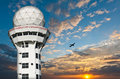 Air traffic control tower with airplane Stock Photos