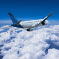 Air travel concept jet above the clouds square composition Stock Photos