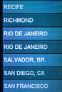 Air travel destinations airline scheduled flight on monitor in airport lists recife richmond rio de janeiro salvador san diego and Stock Image