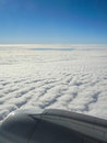 Air travel view of clouds and horizon from an airplane window Royalty Free Stock Images