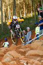 Airborne in final run over rocks at UCI MTB World Stock Photos