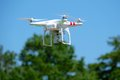 Airborne quadcopter this hovers in position Stock Photography