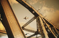 Airbourne passenger jet viewed through bridge superstructure Royalty Free Stock Photo