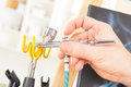 Airbrush hand putting a professional on the stand Royalty Free Stock Photography