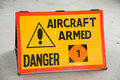 Aircraft armed sign warning that a fighter is Stock Photography