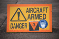 Aircraft armed sign warning that a fighter is Royalty Free Stock Image