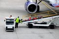 Aircraft baggage loading, Birmingham. Royalty Free Stock Photo