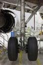 Aircraft chassis repairing in hangar Royalty Free Stock Photos