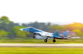 Aircraft fighter jet takes off at speed