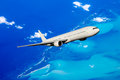 Aircraft in flight huge white flying over the bahamas Stock Image