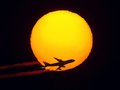 Aircraft flying through the sun airplane Stock Photos