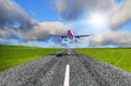 Aircraft landing on the airport runway Royalty Free Stock Image
