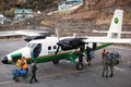 Aircraft maintenance airport staff of the tenzing hillary airport in lukla nepal serve arrived of tara air famous nepalese airline Stock Photography