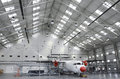 Aircraft maintenance hangar modern with white atr airplane under Stock Images